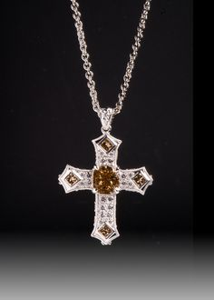 JPratt Designs: Custom designed and custom created diamond pendant holding a radiant champagne diamond with many other diamond accents