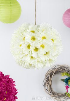 Daisy-decked paper lanterns turn the awesome factor up a notch! We used low-temp hot glue to adhere cut-from-the-bush blooms to the lanterns and hung them at varying heights with jute.