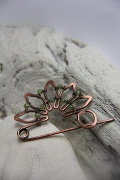 Pretty combination of spring color of peridot and copper makes with shawl pin look classy and elegant. Oxidation gives it vintage, aged look with