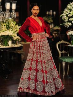 Red Indian wedding gown by Manish Malhotra maybe in lighter color...