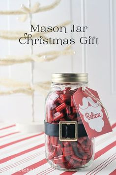 All you need is a un marked mason jar some red candy a black ribbon a little.tag with string and a mini belt buckle kin of thing you can find cheap at a craft store