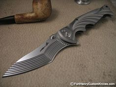 "Brian Tighe has been on the ""cutting edge"" of unique custom folding knives for more than a decade. Description from v3.forthenrycustomknives.com. I searched for this on bing.com/images"