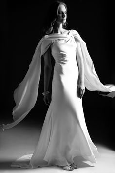 Wedding dress with fluid cape detail