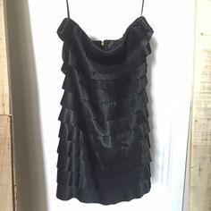 """Express Tiered Ruffle Little Black Dress Express Tiered Ruffle Little Black Dress. Very flattering! Size 0 measures: 29"""" around top, 14"""" across waist, 17"""" across hips, 26"""" long front, 23"""" long back. Ruffles are 100% polyester, lining is 97% polyester, 3% stretch. Express Dresses Prom"""