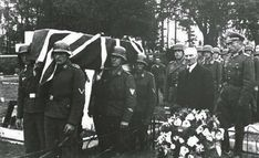 A RAF airman is buried with full military honors by occupying German soldiers, 1943 on Jersey in the Channel Islands.