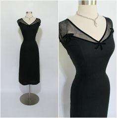 black light weight linen fabric - side metal zipper - two layers of black netting at the neckline - black velvet trim around
