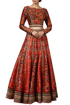 Featuring a red paneled lehenga skirt crafted in poly dupion and raw silk with floral pattern all over and border. It comes along with a matching full sleeved cut out back crop top in poly dupion and raw silk with multicolor pattern all over.  Fabric: Poly dupion, Raw silk  Care Instructions: Dryclean only.