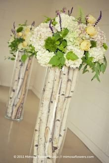 Branches in tall vases - neat filler idea.  Add your favorite flowers on top.  Great rustic or winter wedding idea.  DIY