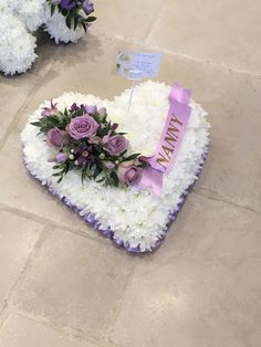 A traditional love heart funeral tribute based with white chrysanthemums topped with a beautiful flower spray. Edged with colour coordinated pleated ribbon Grave Flowers, Cemetery Flowers, Funeral Flowers, Funeral Floral Arrangements, Beautiful Flower Arrangements, Beautiful Flowers, Funeral Sprays, White Chrysanthemum, Funeral Tributes