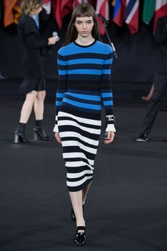 Karlie Kloss steps out in stripes as she takes on New York's cold in a midi dress   | Daily Mail Online
