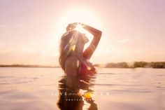 Pastel sunflare, sunset beach photoshoot in and underwater, woman wearing pink…