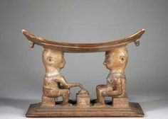 "Fanti figural stool:  - ""The large fine stool of classical form in the form of two fully carved seated figures facing one another across a low table; one figure with hand to bowl atop the table, undoubtedly depicting an Akan proverb. Remains of white pigment and signs of having been washed in a traditional context. """
