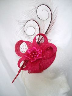 Cerise Fuchsia Pink Isadora Curl Feather Sinamay Fascinator Hat £36.50 Order Now from www.indigodaisyweddings.co.uk Specialising in stunning bespoke cocktail fascinators and formal hats in a wide range of colours, perfect for Royal Ascot and The Kentucky Derby. Plus all your wedding floral accessories including shoe clips, vintage flapper bands, feather and flower fascinators, feather fans, fairy wands, wrist corsages, wedding bouquets & buttonholes. Worldwide Delivery.