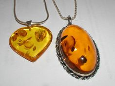 Amber pendants with small fossils