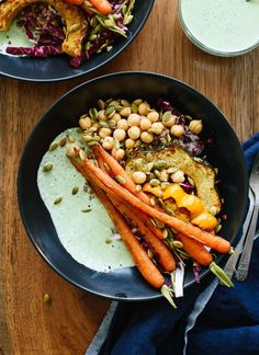 These farmers' market bowls feature roasted veggies, warm whole grains, chickpeas and creamy green goddess sauce. It's a healthy vegetarian dinner recipe!