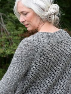 An open-work stitch pattern definesBattine. Knit in Berroco Inca Tweed, this cardigan is knit in pieces and seamed before being topped with a wide-ribbed neckline.