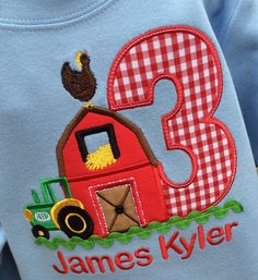 Appliqued Barn in Red With Age Appliqued in Red Gingham Check.Embroidered farm chicken atop and green tractor beside. Finished with Lime Green Ric Rac