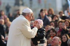 Pope Francis kisses a child 1 in St. Peter's Square for the general audience, Dec. 9, 2015. Credit: Daniel Ibanez/CNA.