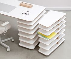 The Strates Desk is the best solution for storage, using layers as a means of expanding storage space on your desk.