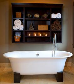 #FreeStandingTub that accentuates the warm tones of the #bathroom  - www.remodelworks.com