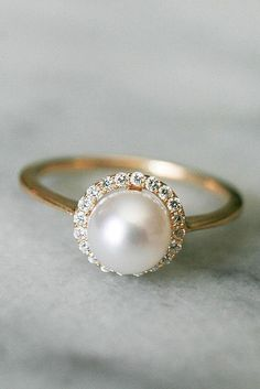 Pearl Engagement Rings For A Beautiful Romantic Look ❤️ pearl engagement rings halo rose gold ❤️ More on the blog: https://ohsoperfectproposal.com/pearl-engagement-rings/