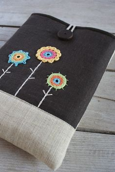 just bought this! Laptop sleeve for macbook 13 inch /linen /handmade wooden button. $45.00, via Etsy.