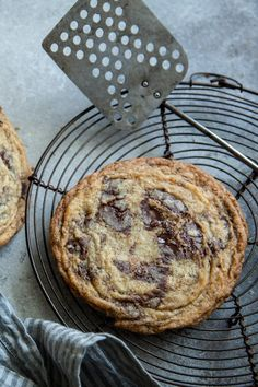 "NYT Cooking: You might think there's nothing new to learn about chocolate chip cookies, but this recipe by the baker and blogger Sarah Kieffer will prove you wonderfully wrong. The easy trick of banging the pan a few times during baking, causing the cookies to ""fall,"" produces rippled edges that shatter in your mouth and a center that is soft and full of chocolate. Make sure to follow her instructions about..."