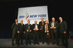 Executive Director of the 2011 WPFG Bill Brooks, 2011 WPFG, President, Jim Carney, with Honorees Anheuser-Busch Inc., represented by Mike T...