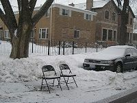 """Chicago """"dibs"""" parking after a snowstorm."""