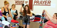 Sorting through clothing in preparation for the Culture of Compassion giveaway in Rumford on Saturday are, from left, Stormy Miller, Whitney Emerson, Ethny Blodgett and Laura Chesley.