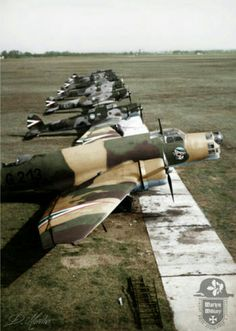 """1939 - Kecskemét Airfield, Hungary. Junkers Ju 86K-2 bomber of the 3/1 """"Arrow of God"""" Bombing Company, with Heinkel He 70K reconnaissance planes from the 1/2 """"Stork"""" Long-range Reconnaissance Company in the background."""