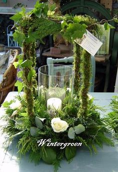Use glass piece from candles and a candle in an arrangement similar. Floral Centerpieces, Wedding Centerpieces, Wedding Table, Floral Arrangements, Wedding Decorations, Centrepieces, Deco Floral, Arte Floral, Floral Design