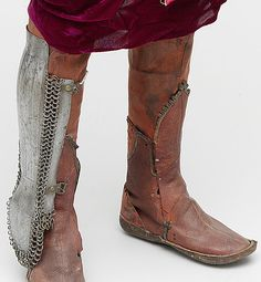 Ottoman mail-and-plate kolçak (greaves or shin armor) shown with a pair of leather boots, possibly Ottoman.