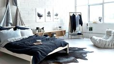 scandinavian bedroom with dark hide rug and linen bedding by the life creative for feast watson