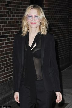 Edgy look: The actress  wore the same see-through black blouse and unique pink glasses as she appeared on The Late Show with Stephen Colbert on Thursday