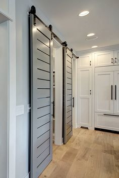 The sliding barn doors were custom, designed by CVI Design and made by a carpenter.