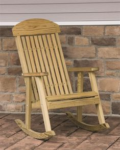 LuxCraft Pine Wood Porch Rocker from DutchCrafters Amish Furniture. Made in Ohio from pressure treated kiln dried yellow pine, this solid wood rocker is a great way to relax outdoors. It also makes a great gift for any occasion. Some assembly required. #woodenporchrockers #outdoorrockingchair #patio #comfortable