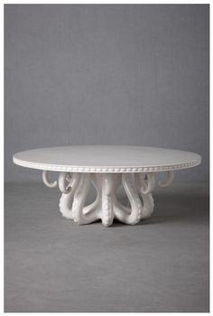 Technically a cake stand, but it'd be lovely to put a vase of flowers on, too.