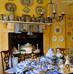 in the yellow & blue and white kitchen of Roger Banks-Pye of Colefax and Fowler