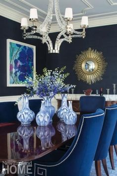 The husband's love of rich color is addressed in the dining room with its blue grasscloth walls and blue-velvet chairs. Dining Room Blue, Dining Room Table Decor, Elegant Dining Room, Dining Room Walls, Dining Room Design, Living Room Decor, Dining Tables, Outdoor Dining, Blue Velvet Chairs