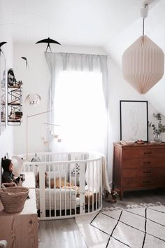 Gender neutral nursery vintage theme rustic chic white and wood nursery decor