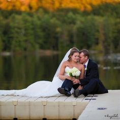 Gorgeous fall Adirondack wedding on the lake of Camp Forest. Photo: Krystal Balzer Photography