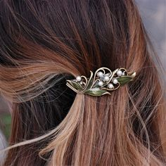 This Lily of the Valley Hair Barrette has strong Art Nouveau influences in its winding stems and leaves delicately placed in your hair. Let the pearls and detailed leaves do the talking. By Sweet Romance Jewelry USA