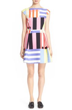 Perfect for spring, this multicolor and multidirectional striped dress is a true…