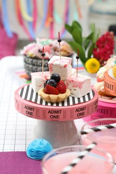 Cool DIY idea for your Academy Awards party... top the cake stands, or stack the ticket rolls for fun, colorful dimension at the treat table.
