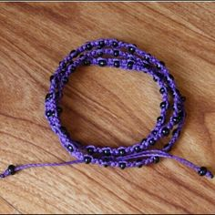 """Ketzali """"Xubal Triple Wrapped Bracelet"""" Color popping purple triple wrapped bracelet by Ketzali.  Perfect boho accessory!  Material:  100% waxed polyester thread with black beads.  Handmade in Guatemala.  First photo courtesy of Ketzali. Ketzali Jewelry Bracelets"""