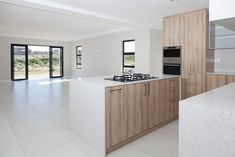 The house is located near the beautifully landscaped walkways towards the Langebaan Country Estate Clubhouse and the Oxigym. Cupboard Door Design, Cupboard Doors, Grey Cupboards, Central Island, Building Contractors, Built In Ovens, Timber Wood, Construction Design, Country Estate