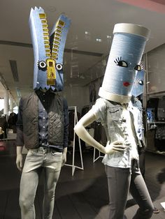 "www.retailstorewindows.com: H, London  headless mannequins are less expensive than headed ones and these creative paper box heads are a great alternative.  Even in using wire to ""imitate"" a mannequin when a shop has none can be added to by using box heads to call attention to the garments"