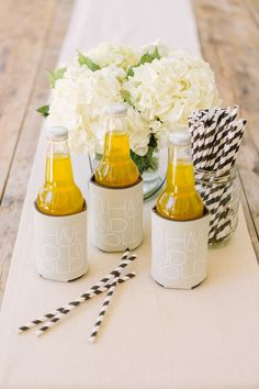 a wedding koozie turned chic Photography: Matt Edge Wedding Photography - mattedgeweddings.com  View entire slideshow: Fabulous Favors on http://www.stylemepretty.com/collection/303/