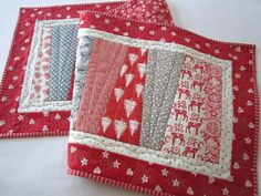 "Christmas Table Runner 16"" x 47"" This table runner has Christmas fabrics sewn into wedges. Mainly gray and red fabrics make this table runner perfect to go with your Holiday decor. This runner uses fabric that has a Scandinavian accent. A great piece to give as a gift. This table runner is 16"" x 47"". The fabric is made with 100% cotton. Warm and Natural from Warm Company was used for the batting. I used a cotton thread and quilted a variety of stitches throughout the table runner. The…"